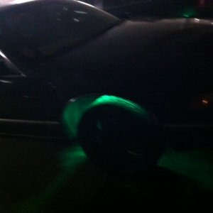 plasti dip rim with the neon green behind it lifted all the way up